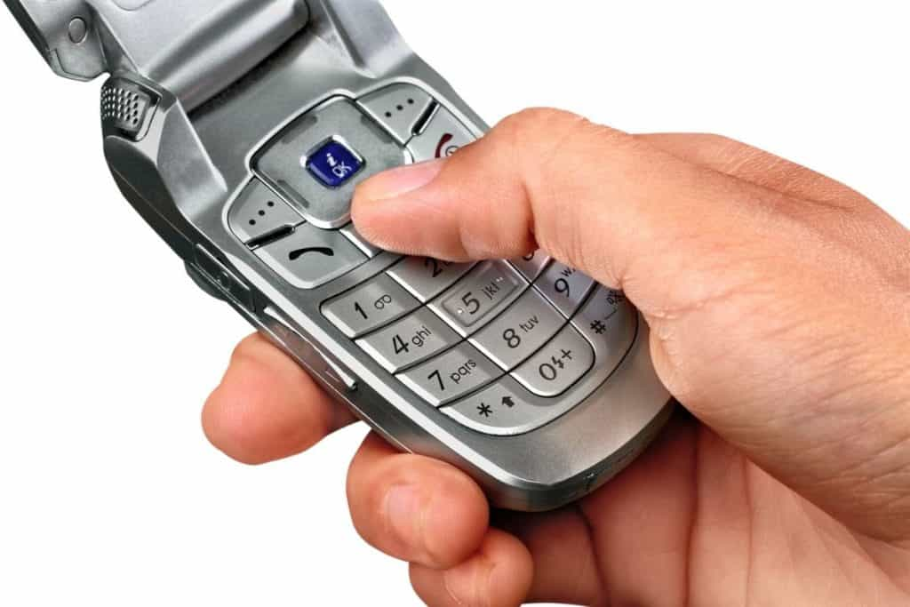 Extreme Frugality - Close up of a flip phone