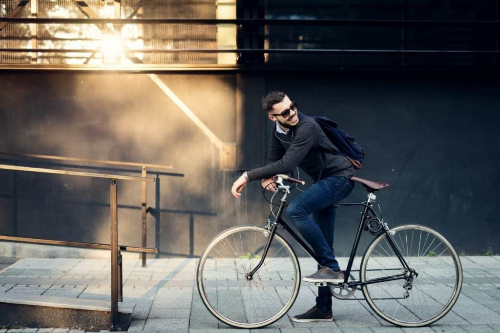 Extreme Frugality - Man riding a bike to work