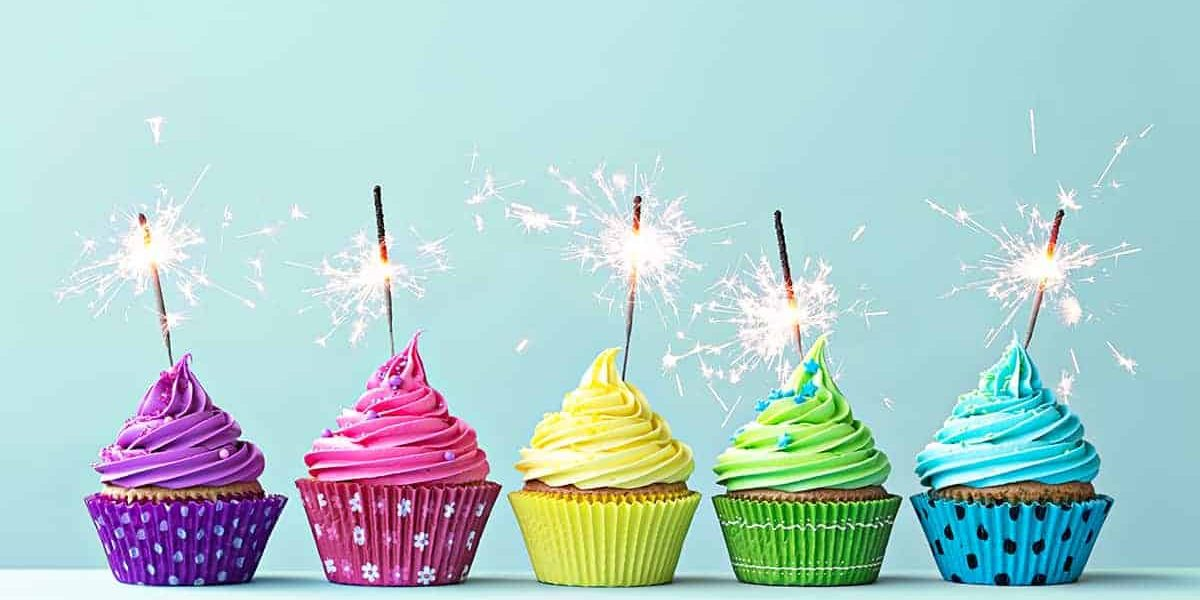 Cupcakes with sparklers to celebrate birthday savings and deals
